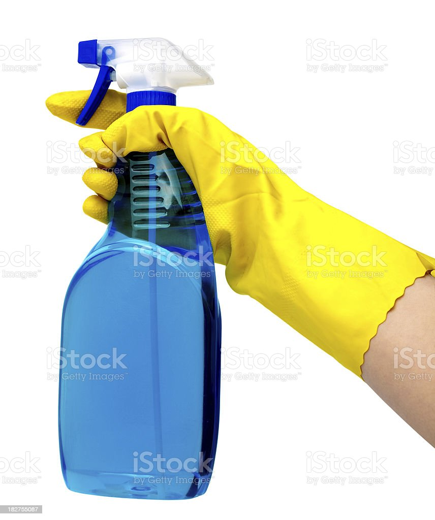 Spray bottle in hand royalty-free stock photo