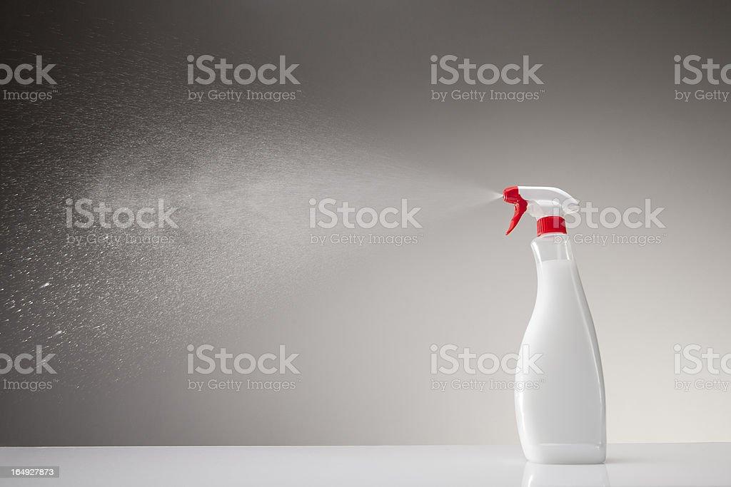 Spray bottle studio shot on gray gradient background stock photo