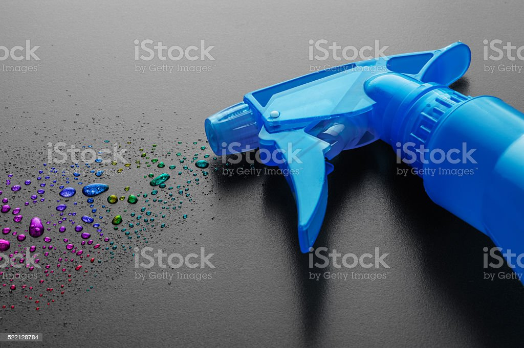 Spray bottle with colorful drops stock photo