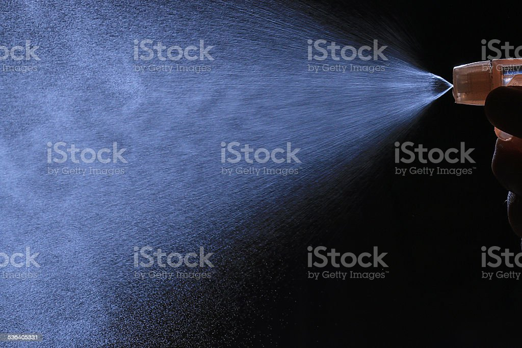spray from the atomizer spray on black background overlay stock photo