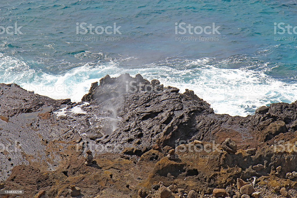 Spray from the Halona Blowhole in Hawaii stock photo