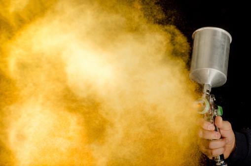 photo of spray gun isolated on black background