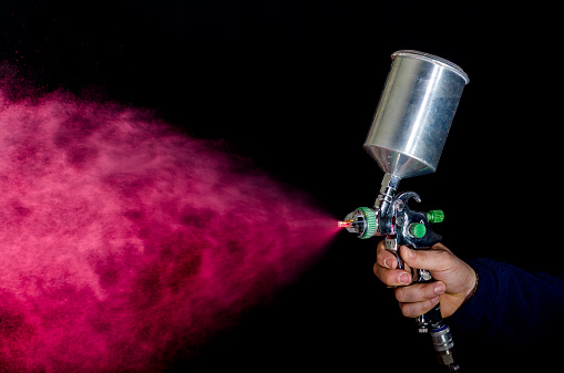 Photo of spray gun isolated on black background