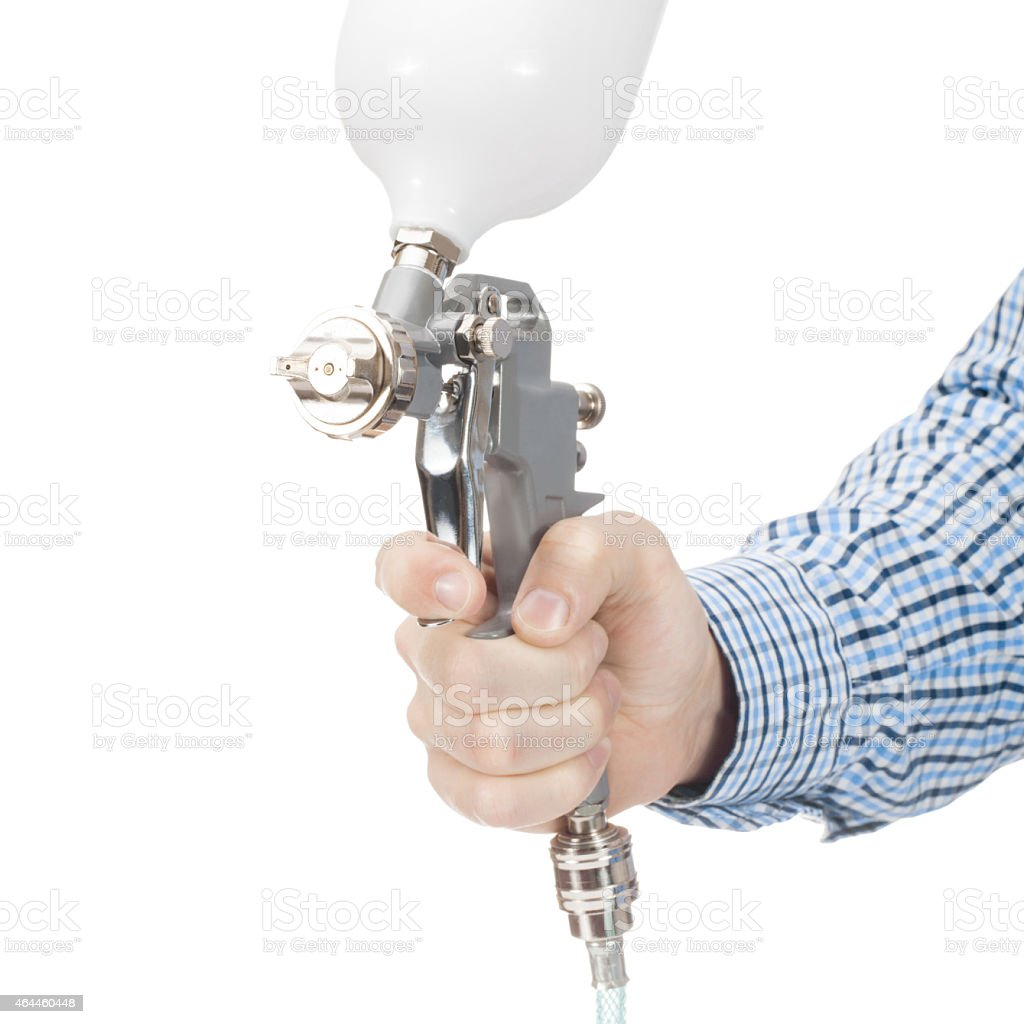 Spray gun used for industrial painting and coating stock photo