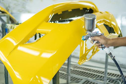 istock Spray paint, yellow front bumper 1154068745