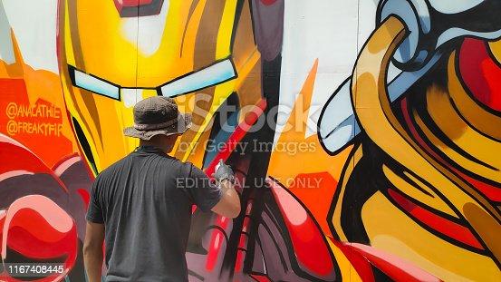 Singapore - September 09 2018: Street artist doing a mural in Sentosa Island.