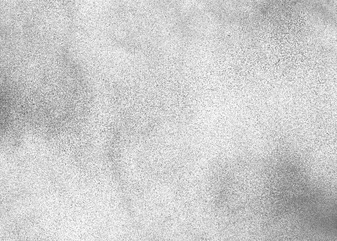 Subtle grain texture. Abstract black and white gritty grunge background. Dark paint spray particles on paper