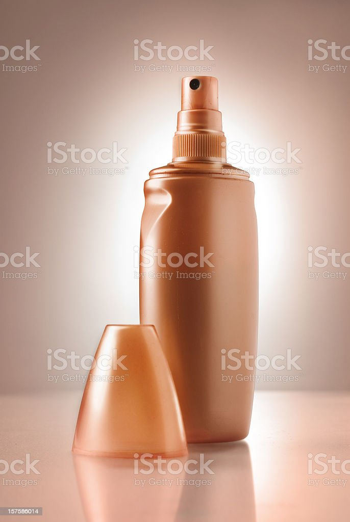 Spray tan bottle stock photo