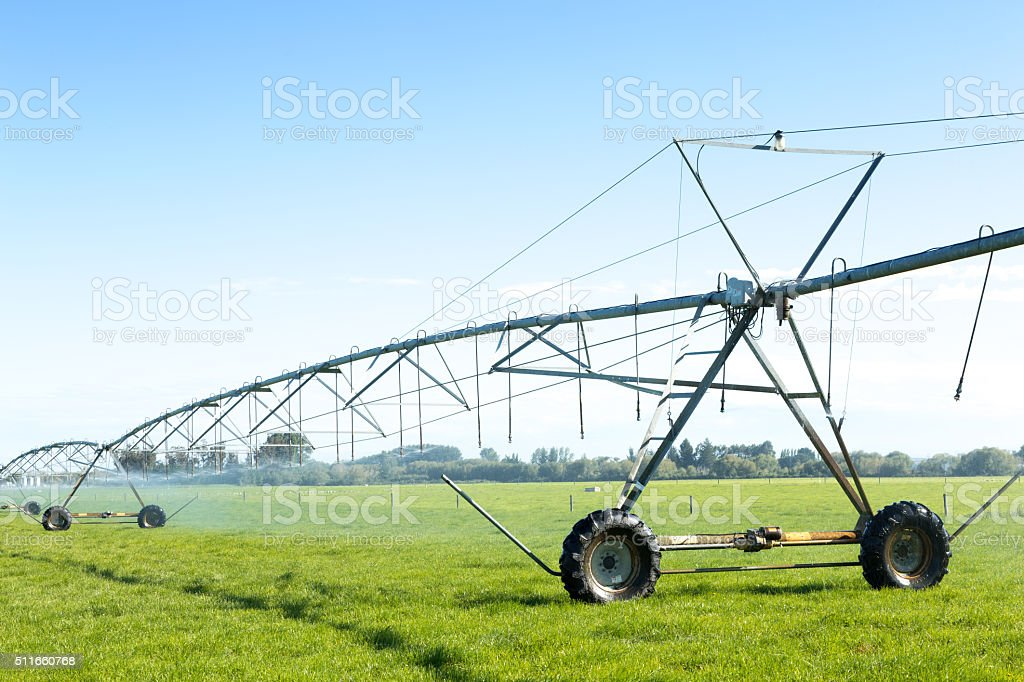 spray water machine in grassland stock photo