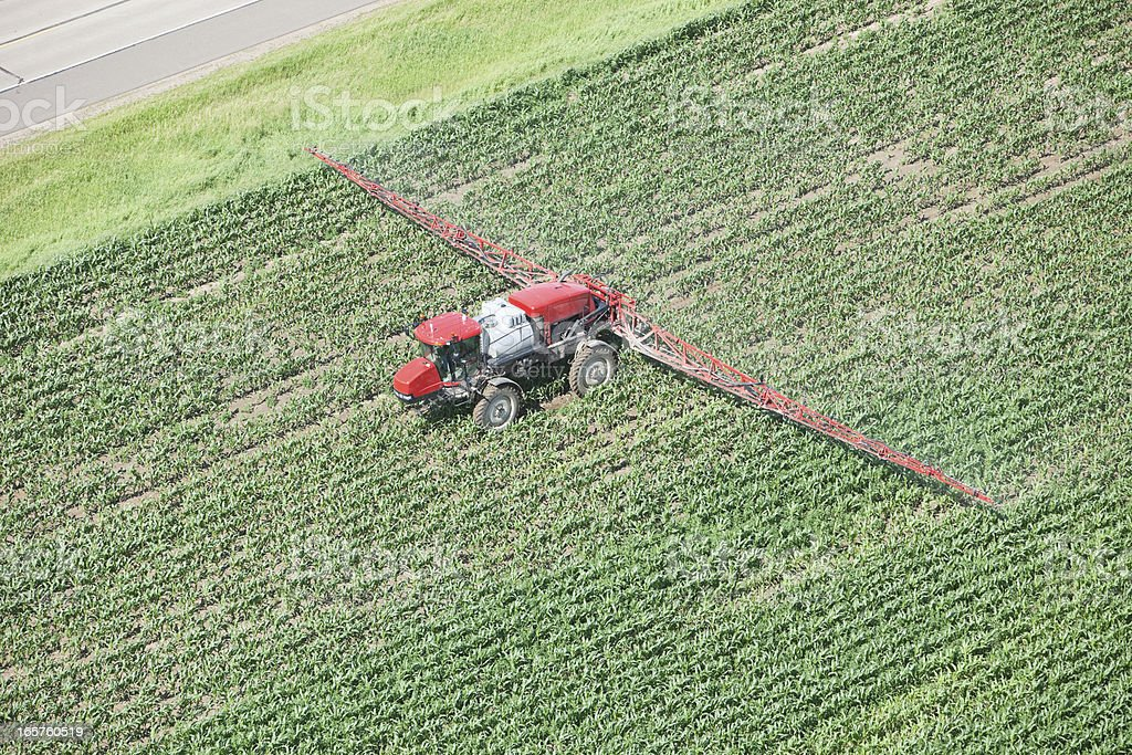 Sprayer Applying Liquid Nitrogen Fertilizer to Corn Field royalty-free stock photo