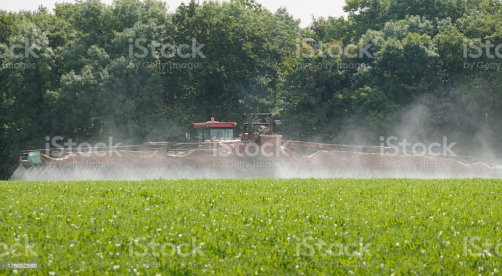 Spraying a Crop of Peas in the Cotswolds royalty-free stock photo