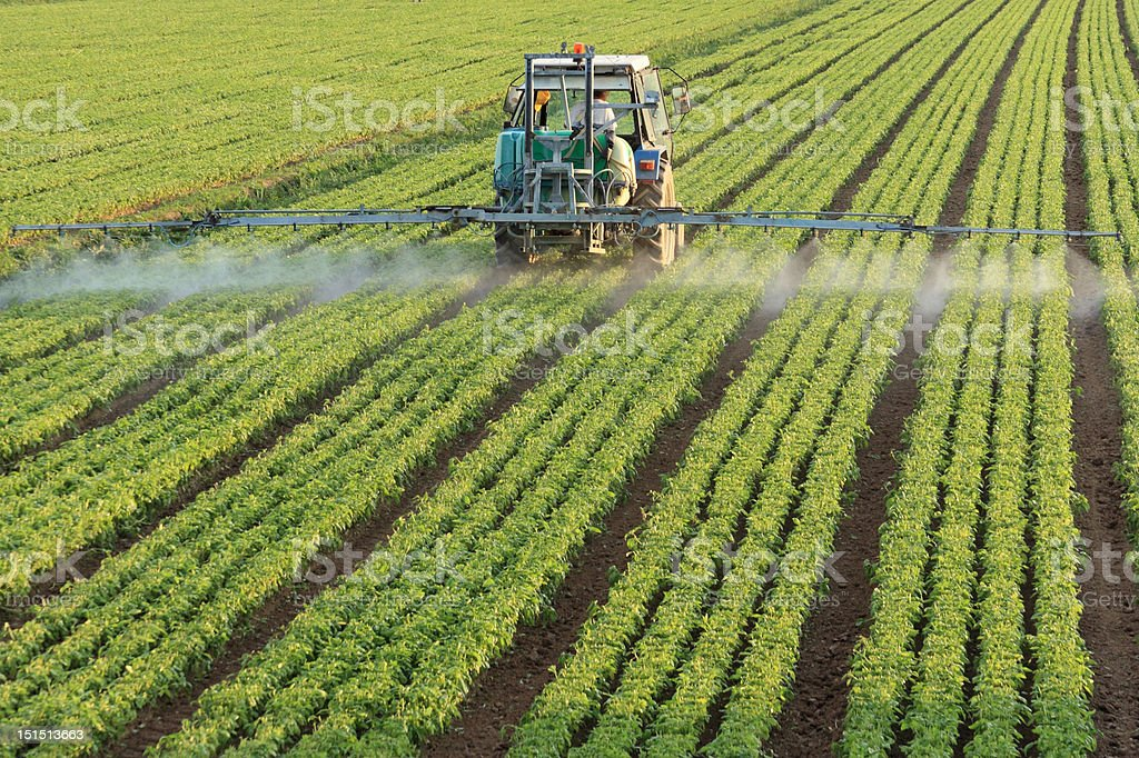 spraying a field royalty-free stock photo