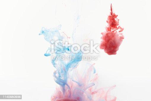 istock spraying abstract acrylic paint 1140680936