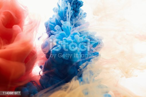 istock spraying abstract acrylic paint 1140681977