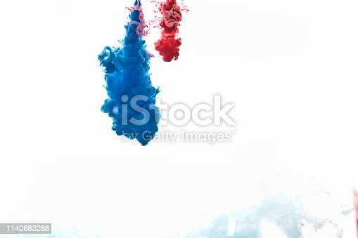 istock spraying abstract acrylic paint 1140683268