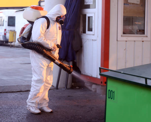 Spraying, disinfection and decontamination on a public place. stock photo