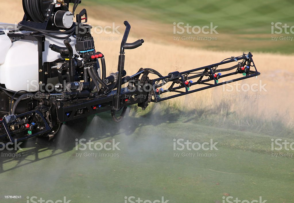 Spraying Liquid Fertilizer on a Golf Course stock photo