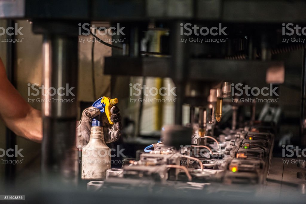 Spraying Oil over the Cold Press stock photo