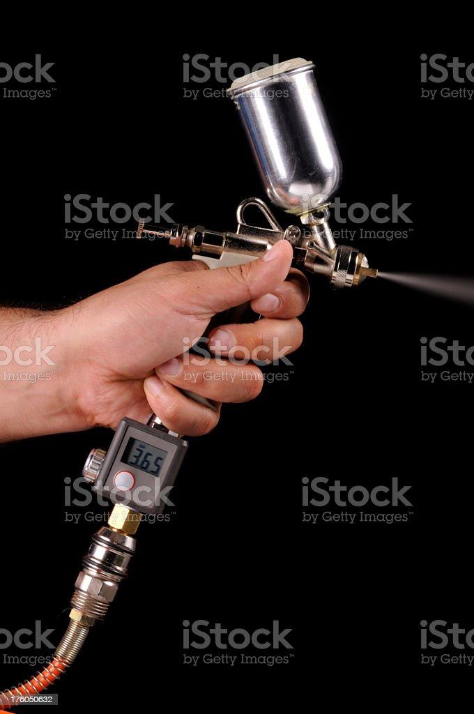 Spraying Paint Gun royalty-free stock photo