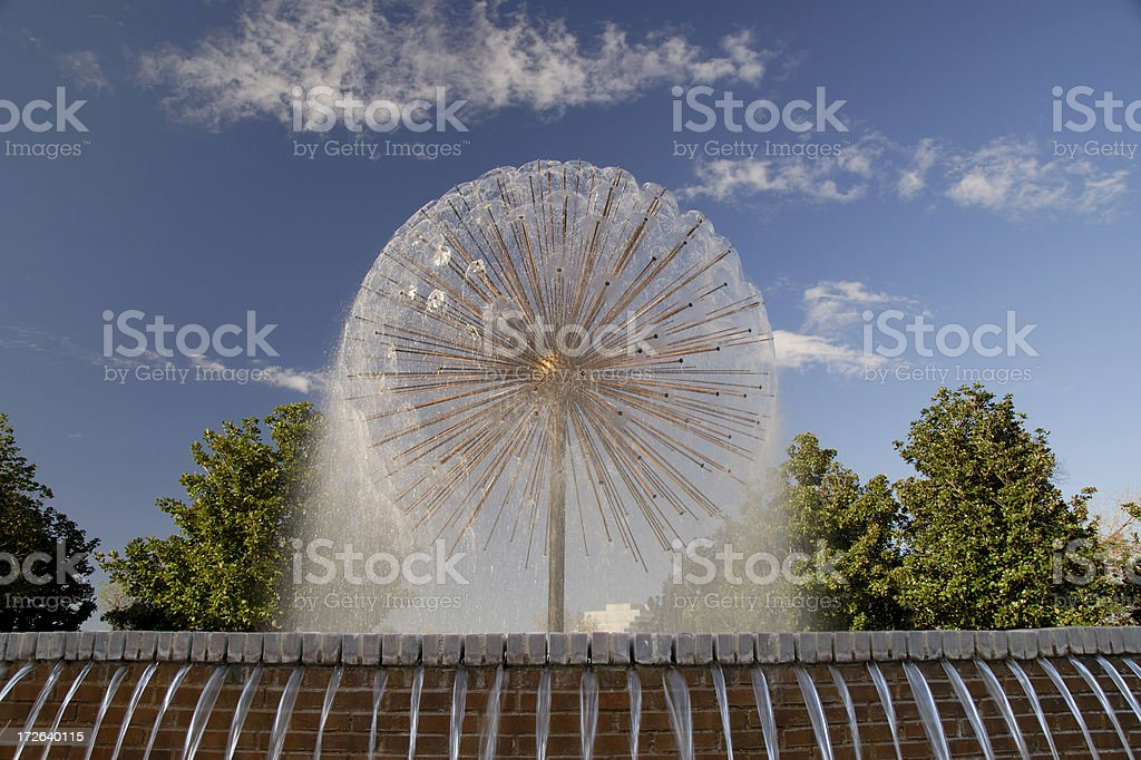 Spraying Spherical Fountain In City Park royalty-free stock photo
