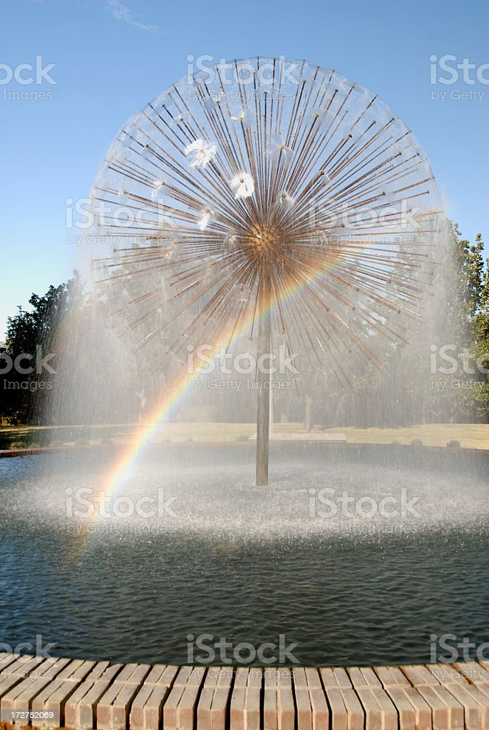 Spraying Spherical Water Fountain With Rainbow royalty-free stock photo