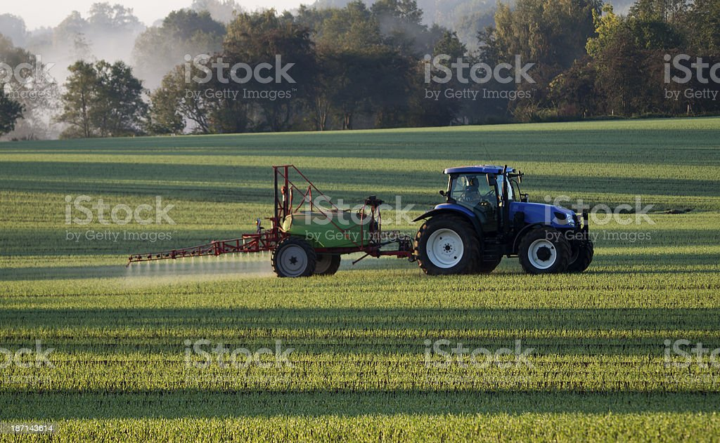 Spraying the field royalty-free stock photo