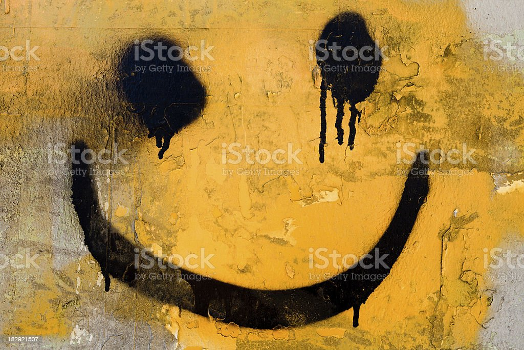 spraypainted smiley face stock photo