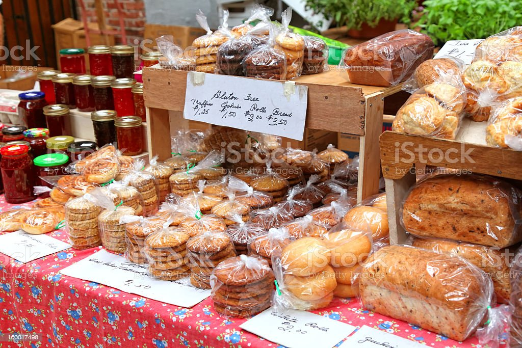 A spread of baked goods and jam at the farmers market royalty-free stock photo