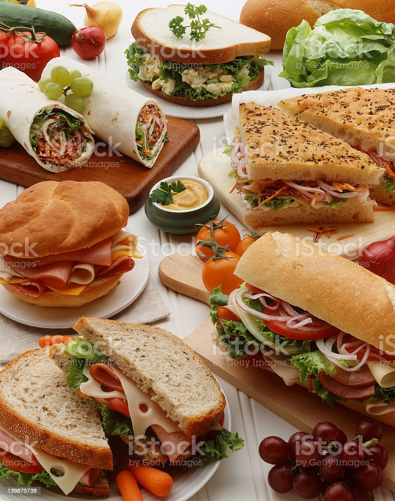 Spread of different types of meticulously styled sandwiches stock photo