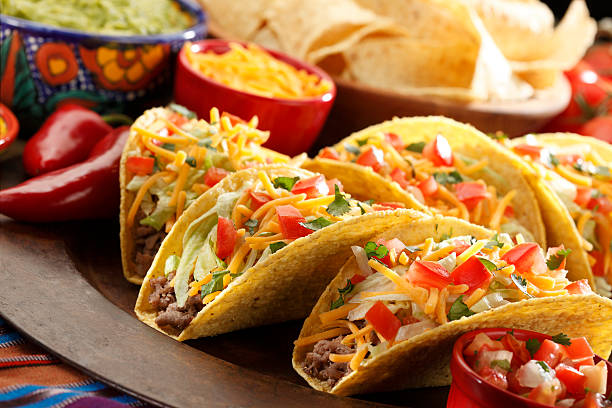 spread of mexican tacos with all the fixings - mexican food stock photos and pictures