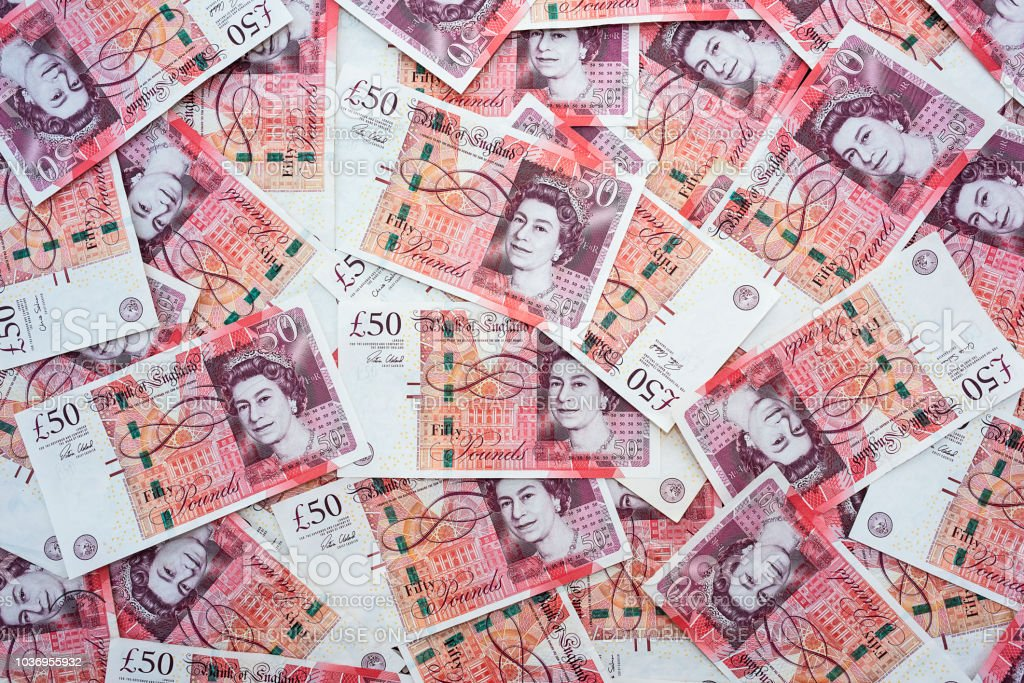 Propagation d'aléatoire 50 notes de livre sterling - Photo