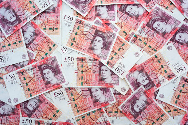 Spread of random 50 British Pound notes Close up of English sterling fifty pound notes british currency stock pictures, royalty-free photos & images
