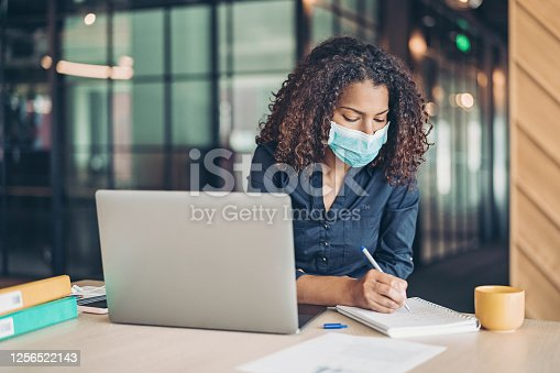 Businesswoman working wearing a protective mask