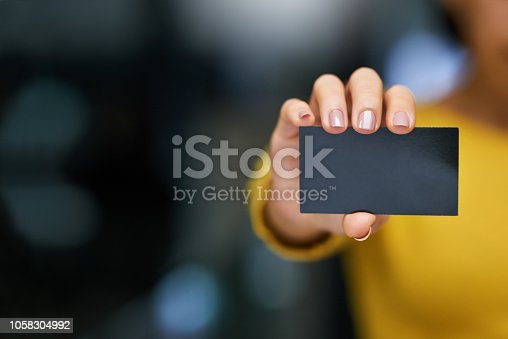 Cropped shot of an unrecognizable woman holding a blank card