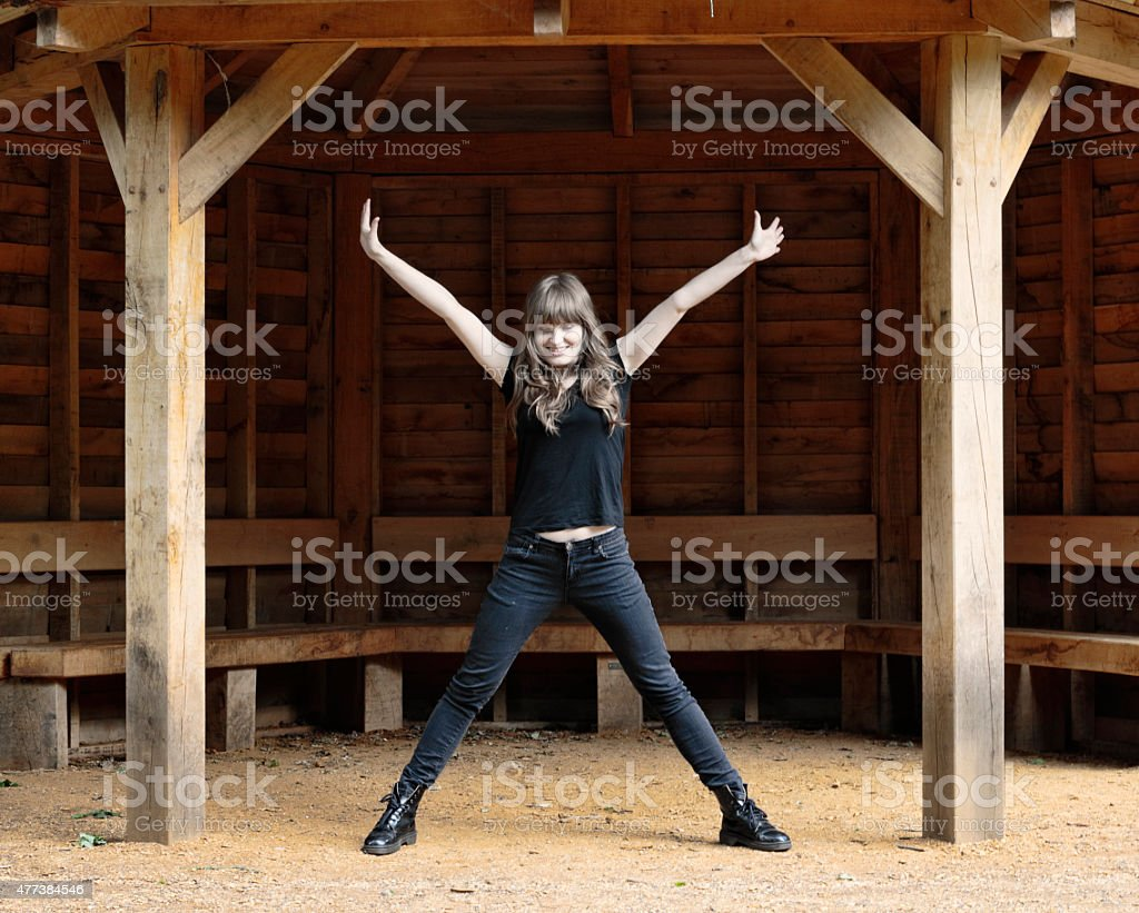 Spreadeagled position for Latvian outdoor girl model stock photo