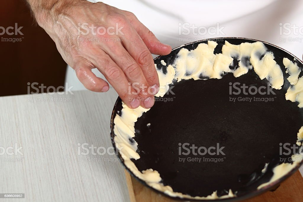 Spreading butter over edge of skillet stock photo