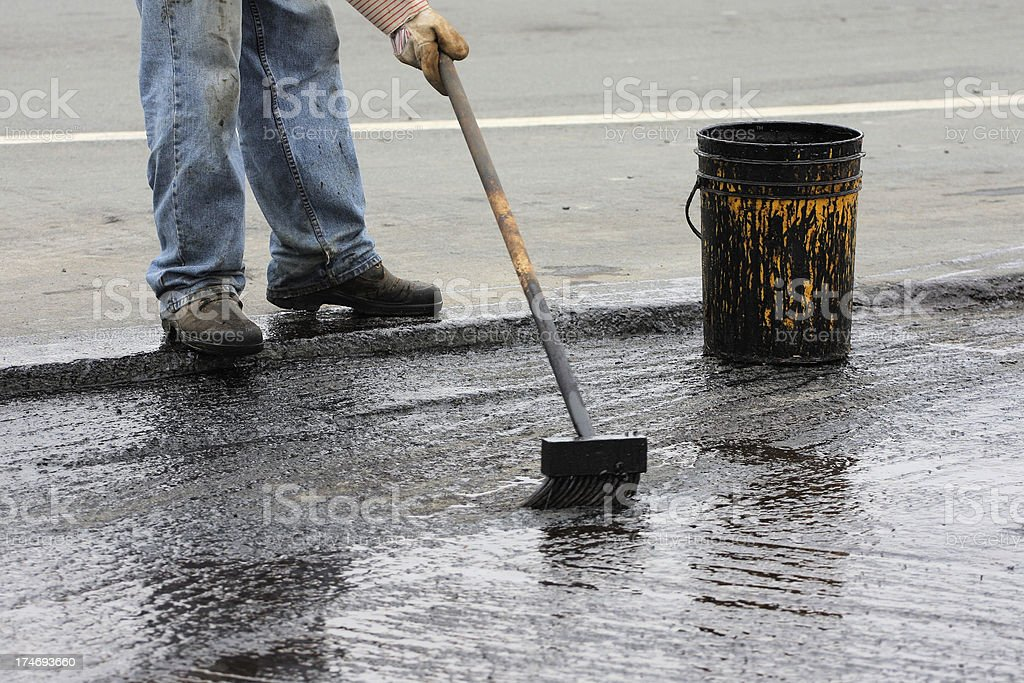 Spreading Hot Tar royalty-free stock photo