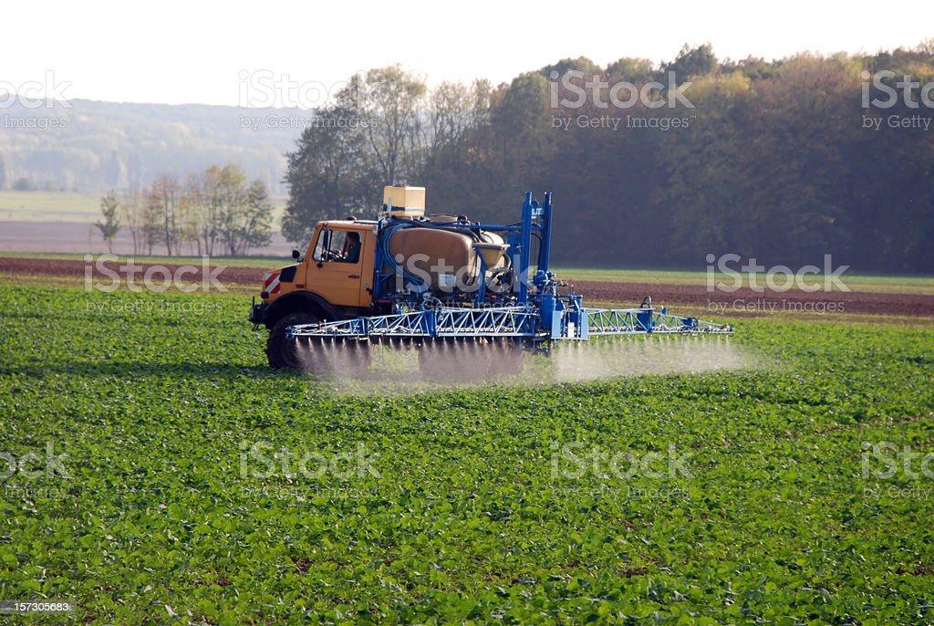 spreading pesticide stock photo