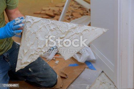 1138442636 istock photo Spreading wet mortar before applying tiles on bathroom floor 1219364801