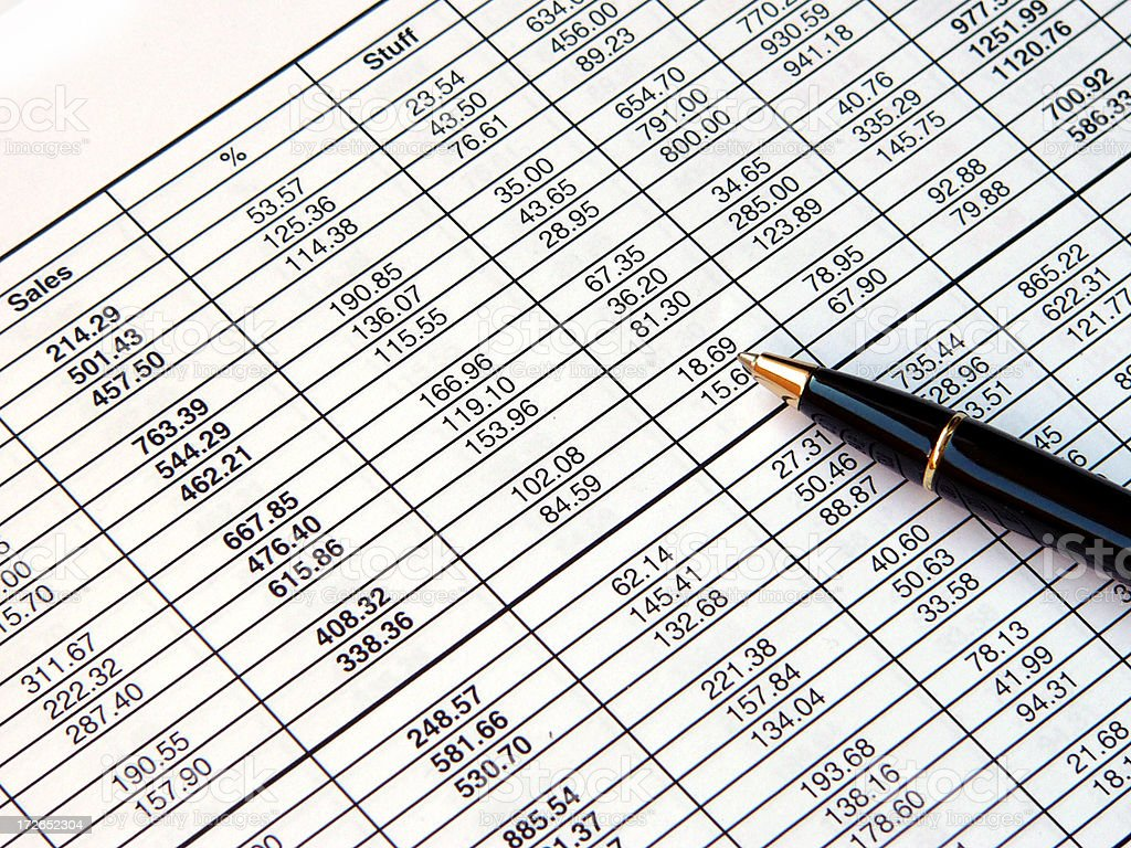 Spreadsheet and pen royalty-free stock photo