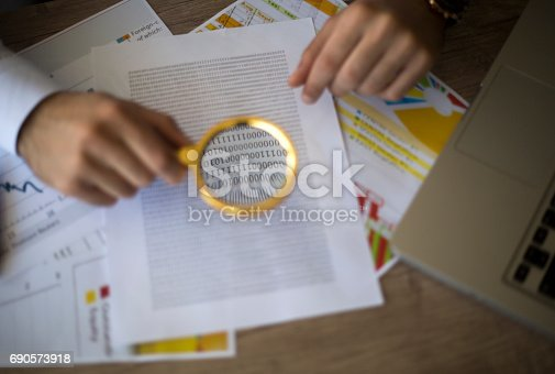 istock Spreadsheet bank accounts accounting with and magnifying glass 690573918
