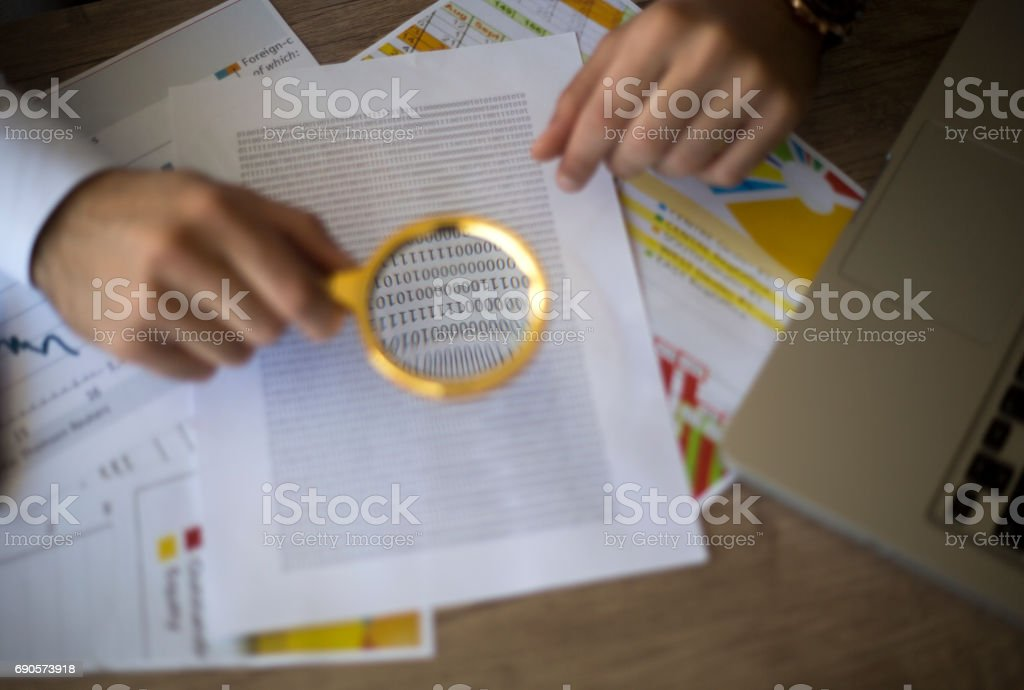 Spreadsheet bank accounts accounting with and magnifying glass stock photo