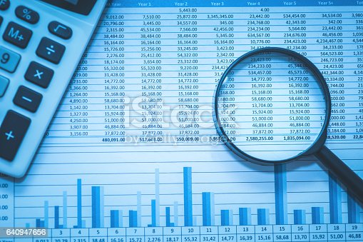 istock Spreadsheet bank accounts accounting with calculator and magnifying glass. 640947656