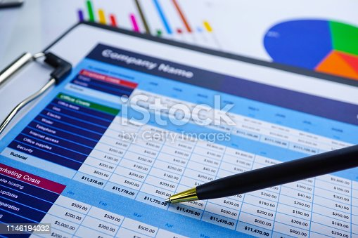 640947656istockphoto Spreadsheet table paper Finance development, Account, Statistics Investment Analytic research data 1146194032
