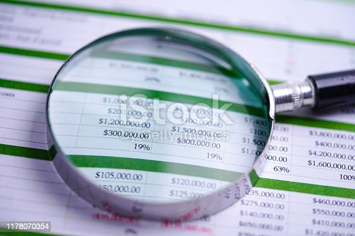 640947656istockphoto Spreadsheet table paper with pencil. Finance development, Banking Account, Statistics Investment Analytic research data economy, trading, Mobile office reporting Business company meeting concept. 1178070354