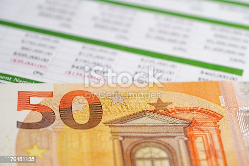 640947656istockphoto Spreadsheet table paper with pencil. 1176481135