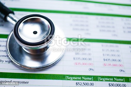 640947656istockphoto Spreadsheet table paper with stethoscope . Finance development, Banking Account, Statistics Investment Analytic research data economy, trading, Mobile office reporting Business company meeting concept. 1146192870