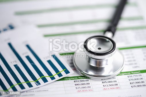 640947656istockphoto Spreadsheet table paper with stethoscope . Finance development, Banking Account, Statistics Investment Analytic research data economy, trading, Mobile office reporting Business company meeting concept. 1171445460