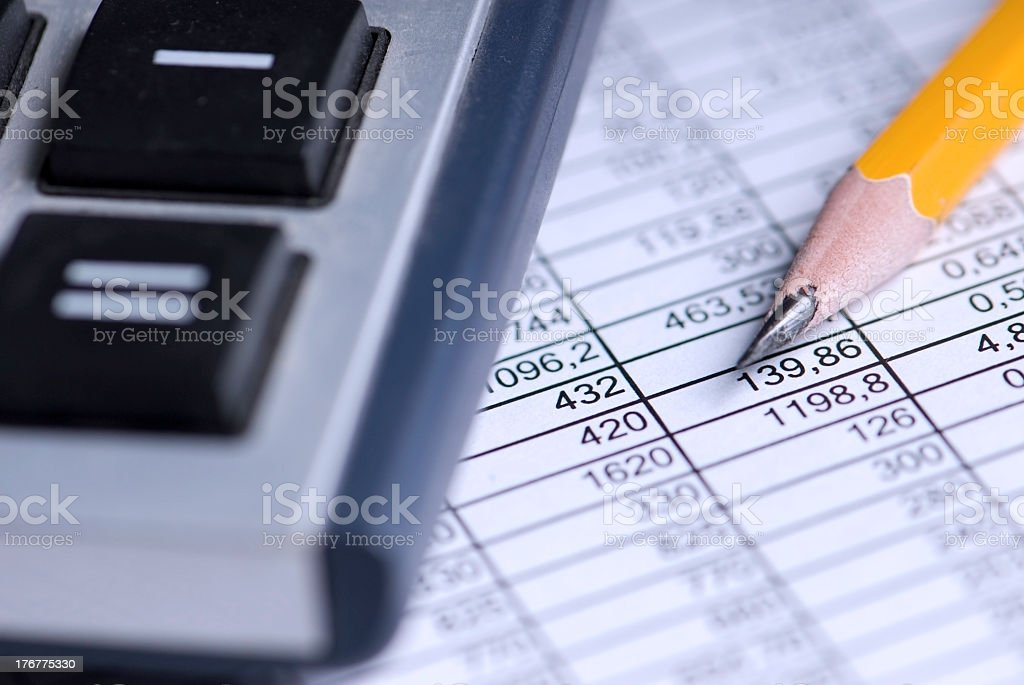 Spreadsheet with calculator and pencil stock photo