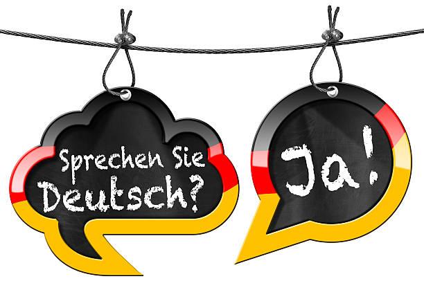 sprechen sie deutsch-sprechblasen - studieren in deutschland stock-fotos und bilder